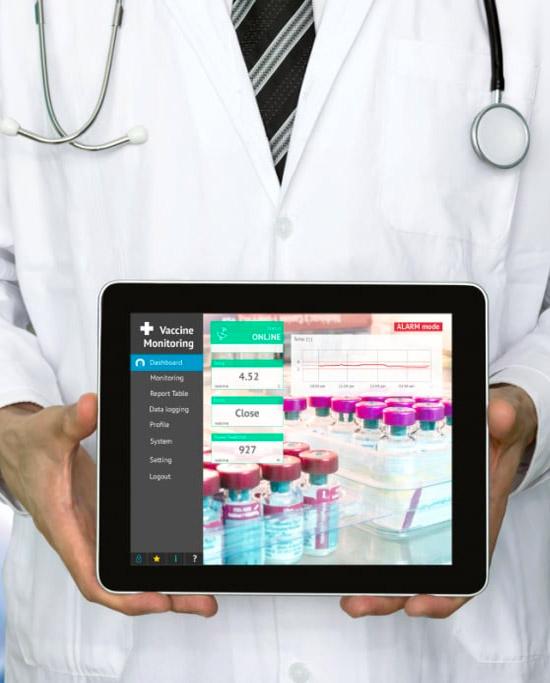 Doctor holding digital tablet showing data